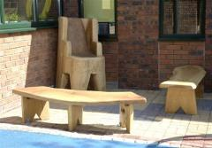 Storyteller seat and benches for school garden