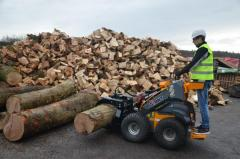 The compact SKIDSTEER tackling the logs with one of our newest wood clamp attachments.